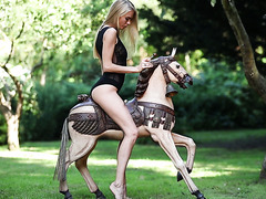 Naughty Nancy A rides a toy horse in a park and then rides red dildo