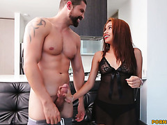 Redhead Colomibian chick Laura Brown sucks a cock in a sexy outfit