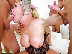 Insane German whore Nina Elle gets face fucked and facialized by a crowd