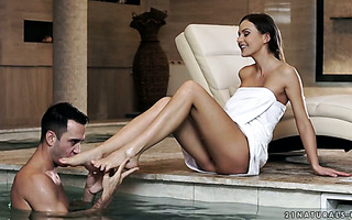 Dude enjoys Tina Kay's sexy feet and pussy in indoor pool