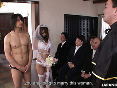 Japanese bride in white lingerie and a veil gives head during wedding ceremony