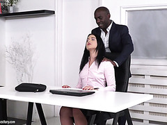 Jess Lincoln gets penetrated by a white and a black dick in the office