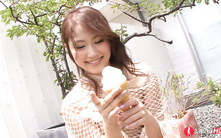 Adorable Iori Mizuki licks an ice cream in a sexy way and fingers herself