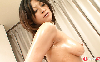 Rio Sasaki oils her body up and gets toyed with a rabbit dildo