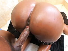 Kytiana shakes her giant ebony ass and takes BBC in a bathroom