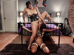 Bondaged Sadie Santana licks Mia Li's vag and gets straponed in her black ass