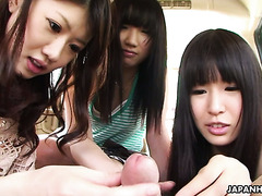 Trio of charming Jap girls treat micro penis with a blowjob in van