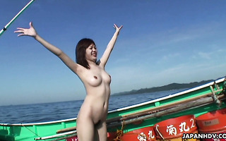 Busty Japanese prostitutes get fucked by fishers on a boat
