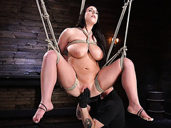 Voluptuous Angela White is brought to orgasms in suspended bondage