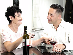 Classy GILF Anastasia treats boy to aged wine and aged pussy