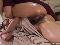 Mature and very hairy Japanese MILF is massaged to climax