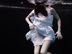 Graceful Andrejka strips her dress off underwater