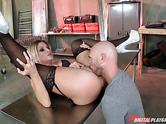 Magnificent blonde in stockings Kissa Sins fucks working on giant shaft