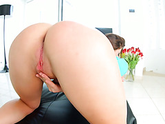 Ukrainian babe Nikki Wayne toy fucks her anal slit with large dildo